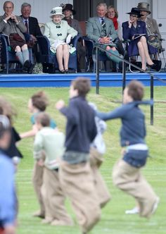 The royal family watched the sack race from the royal box during the | A Look at Charming Prince Philip Through the Years | POPSUGAR Celebrity