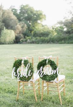 """Green wreaths, gold chairs, bold white cursive """"bride"""" and """"groom"""" signs // Alisandra Photography"""
