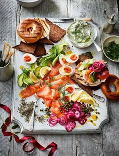 This smoked salmon breakfast platter recipe is ideal for a crowd. Pile bagels high with dill soft cheese, smoked salmon, capers and pickled red onions, or top rye toast fingers with chopped egg, avocado and a sprinkling of seaweed salt.