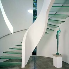 Creative and beautiful glass staircase. It has a feeling of softness and simplicity.