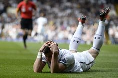 ON THE PITCH: Tottenham Hotspur's Gareth Bale held his head before referee Andre Marriner, left, gave him a yellow card at a soccer match against Sunderland in London Sunday. Mr. Bale scored a late kick to give his team a 1-0 victory, but Tottenham didn't qualify for the Champions League. (Dylan Martinez/Reuters)