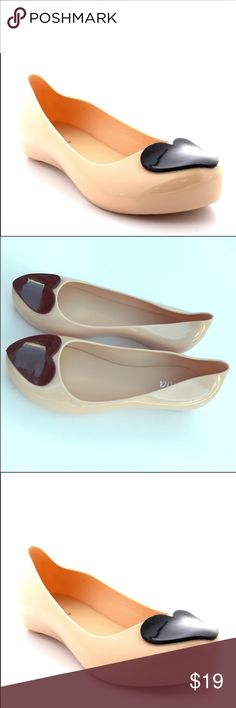 "❤NEW ❤Heart jellies flats tan/nude ladies sz 9 Nude flats with black Heart accent. Jelly shoes. New with tags. They are exactly as pictured. Small, tiny heel not even 1/4."" I have a few pair of these and love them! I get lots of compliments on them. Measures approximately 9.7"" (a little over 9 1/2"") in length. Width at widest part is 3 1/4."" Width at thinnest part is 1.7 (little over 1 1/2"") this is the bottom and not the sides being measured. Width at heel is approximately 2.2 so a little…"