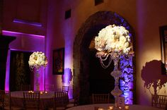 Floral Centerpiece Lighting at Bella Collina. Pin Spot Lighting and Up Lighting by Kaleidoscope. #weddingcenterpiece #weddingcenterpieces #centerpiecelighting #centerpiece #pinspot #pinspotlighting #floralcenterpiece #uniquecenterpiece