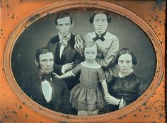 The whole family. great fierceness in the young mother's face Victorian Photography, Old Photography, Old Pictures, Old Photos, Antique Photos, Family Portrait Poses, Tintype Photos, Little Boy Fashion, Black And White Pictures