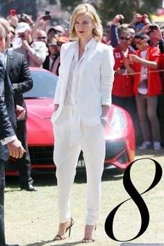 What: Barbara Bui Where: Australian F1 Grand Prix Why: Theron's red lip and undone waves are the perfect compliment to her chic suiting.   - HarpersBAZAAR.com