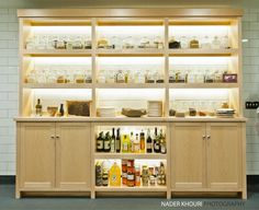 Beautiful Open Lit Cabinet With Spices In Glass Jars Kitchen At The Restaurant Meadowood