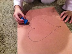 A very unique way to provide kids something to focus on...they use a huge Push Pin to make enough holes in their paper so they can eventually cut it out in their favorite shape!  Inspired by my local Montessori preschool