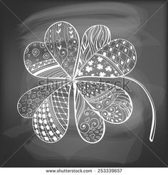 Four leaf, decorative clover filled with hand- drawn floral and geometrical patterns on chalkboard background. St. Patrick's day card. - stock vector