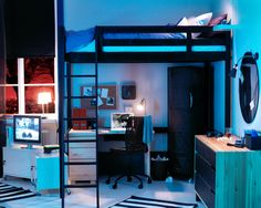 "awesome ikea loft bed. Put desk elsewhere though - keep loft for sleeping and ""lounging"""