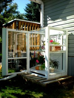 Upright cold frame from old windows, set on a pallet. Good for starting seedlings. Great way to re-use old windows. Homemade Greenhouse, Outdoor Greenhouse, Backyard Greenhouse, Small Greenhouse, Greenhouse Plans, Outdoor Gardens, Window Greenhouse, Greenhouse Wedding, Portable Greenhouse