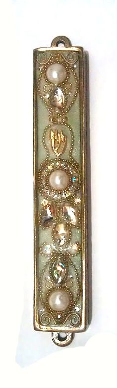 This beautiful Mezuzah Handmade by the Irina Smilansky.   the setting is made from Metal plated and is decorated with Swarovski crystal , metal , stone , brass, gold, silver, beads..     This mezuzah will make a beautiful expression of faith in your home or can be a wonderful gift for anyone who appreciates high quality handmade crafts