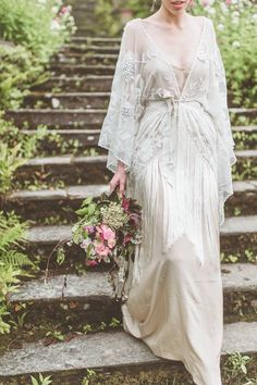 The fringing on this cinched wrap contrasts beautifully with the plain dress beneath. With a lovely floral design, this dress is both elegant yet bohemian.