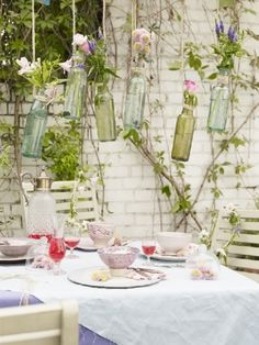 Hanging vase bottles create a delicately pretty outside space