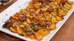 Maple Bacon Pecan Sweet Potato Chips!  What could possibly make crispy sweet potatoes better? How about a topping of candied Bacon?  Now you can't tell me that these won't be a hit on Thanksgiving!
