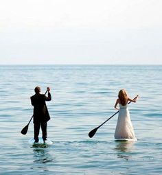 Absolutely love this paddle boarding picture of the bride and groom!