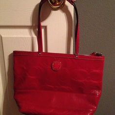 Authentic Coach Purse This is an authentic shiny red coach purse! I love the style and color but it's to small for me! Coach Bags