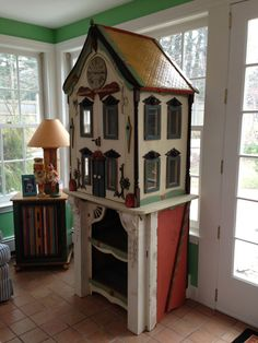 One of a kind custom doll house by artist Richard Dunbrack of the Thieving Magpie.
