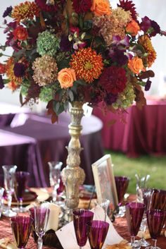 Pretty cool vase/centerpiece stand  Flowers by Holly Chapple Flowers - http://thefullbouquetblog.com/