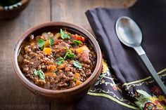Black lentils hold their shape and add a hearty texture while red lentils soften and thicken this smoky, flavorful vegan chili.