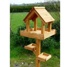 Wooden Bird table, triple table