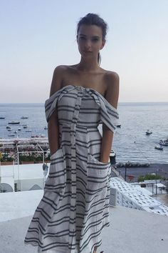 Emily Ratajkowski wearing the Reformation Mariana Dress in Seaside