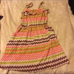 Sundress Your cute earth tones flowy sundress. Has flounce detail at top. Adjustable straps. Size small Dresses Mini