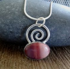 Handmade Mookaite Jasper spiral pendant | natural gemstone jewelry OOAK sterling silver layering necklace from Accessoreese.com.  Lovely ombre pink to this natural stone.