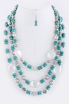 """Beautiuful necklace. Turquoise color beads with silver bead accents. This necklace is sure to dress up just about any outfit. Lobster clasp. 13"""" long, with 3"""" adjustable extender chain. Matching earrings included. 