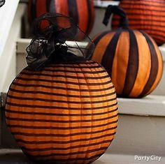 put pumpkins into patterned nylons & tie at the top! so easy and cool.