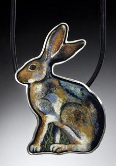 'Jackrabbit' Neckpiece in sterling silver, enamel on copper and leather cord.