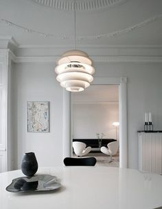 Snowball pendant lamp by Poul Henningsen from Louis Poulsen and Swan armchairs by Arne Jacobsen from Fritz Hansen