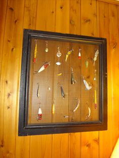Use old window screen to hang antique fishing lures in my camp TV room
