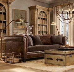 Restoration Hardware living room ...looks like ours...leather sofa, trunk, rug, but no chandelier hmmm