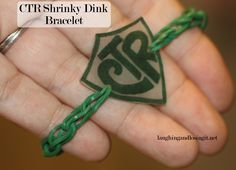 DIY CTR Bracelet make from loom rubber bands and a shrinky dink charm. Full…