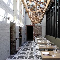Although the building was originally the district's first jail, fear not. The only actual blood you'll see in this stylish restaurant and bar will be oozing from a rare steak...