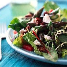 This warm vegetable salad is filled with a flavorful blend of goat cheese, dates, pecans, and a balsamic vinaigrette.