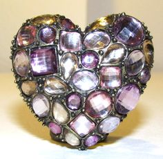 beautiful large rhinestone heart cocktail ring. -beautiful rhinestones in various shades and shapes of pinks and purples -antique brass tone metal -...  #pink #silver #stretch #vintage #jewelry