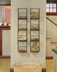 The vintage wall racks shown below are the inspiration for our Wirework Wall Rack from the Catalog for Living. The originals hang in Martha's television studio set in Westport; Martha uses them primarily to hold vegetable staples such as potatoes and onions. Since the racks hang near the kitchen island, their contents are always close at hand for cooking.