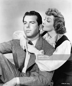 claudette colbert | Claudette Colbert mockingly kisses the ear of Fred MacMurray . Los ...