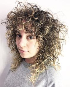 Curly+Brown+Hairstyle+With+Highlights