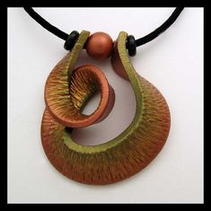 polymer clay jewelry | Polymer Clay Jewelry / twisted pendant - I would like to mirror this in leather. - JK