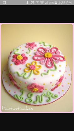 Light purple with pink, purple, and orange flowers, strawberry cake with cream cheese filling