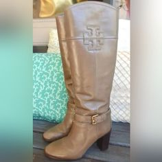 """Tory Burch leather knee high boots Authentic beautiful The perfect fall/winter boot by Tory Burch in taupe leather that features a stacked 'T' logo and buckle embelishment on a 3"""" TPL Certificate of Authenticity included In perfect like new condition Taupe Leather Knee High Boots Size 7.5 Approx. 9.5"""" Insole Measurments Zip Up  Buckle & Logo Details 3"""" Block Heel Made in Brazil Tory Burch Shoes Heeled Boots"""