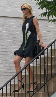 Flirty frock: Ivanka Trump stepped out of her Washington, D.C. home on Monday morning wear a $35 dress with a calla lily print from the Victoria Beckham collection from Target. June 5 2017, shades, sunglasses, walking, ankle strap heels,