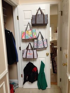 Closet Organization! Use hooks to hang Keep It Caddy bags from Thirty-one on the inside of the closet door to store hats & gloves for each person.