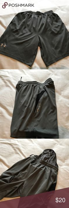 Men's Under Armour Shorts Under Armour Shorts. Still in good condition. Shorts very light weight. Shorts also has underwear lining inside (3rd pic). Bundle for deals! Under Armour Shorts Athletic