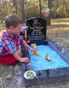 Mom adds sandbox to her life boy's grave so her older son can play with his brother.
