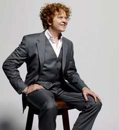 """Mick Hucknall - Mick Hucknall, singer, songwriter, lead singer of the British band Simply Red is recognisable for his smooth, distinctive voice, wide vocal range, as well as his fiery red curly hair! He also produces esteemed wines under the label """"Il Cantante"""" (The Singer), in Catania, Sicily and chooses Sub-Zero Wine storage for his home."""