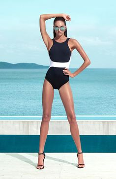 A modern athletic one piece that's anything but basic, this suit features contrasting panels that narrow at the waist and a high neckline which lengthens the look of the torso. Best Suited for: A-C cup.