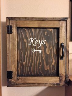 Several months ago, Hubs mentioned that he would like to have a key cabinet to store all the random keys that were strewn throughout his desk drawer. Key Cabinet, Desk With Drawers, Rustic Wood, Ideas, Thoughts